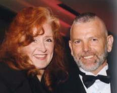 RAN supporter Bonnie Raitt and RAN president Randy Hayes at the 1999 World Rainforest Awards Dinner (Photo courtesy RAN)