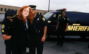 Bonnie Raitt is arrested outside the Boise Cascade building in Itasca today. (Photo courtesy Rainforest Action Network)