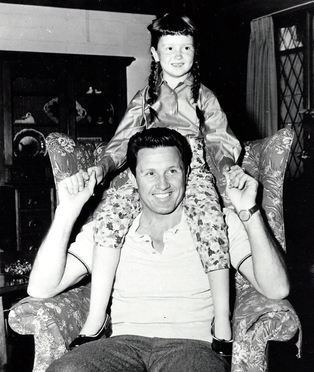 Bonnie Raitt with her father, John, in 1957, while he filmed The Pajama Game in California. © Warner Bros.