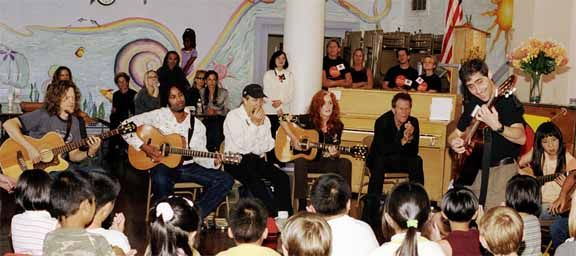 Little Kids Rock - Tom Waits, Bonnie Raitt, Norton Buffalo, Jason Newsted and Austin Willarcy (right to left) take part in jam session at the Spring Valley Elementary School in downtown San Francisco on October 21, 2003. They were there to support the program which was started by David Wish in November 1996 and is a non-profit organization that provides free instruments and lessons to disadvantaged kids in public schools. Some of the artists that serve as board members are Bonnie Raitt, Paul Simon, BB King and Les Paul as well as friend Carlos Santana, Bob Weir and the band, Phish among others.