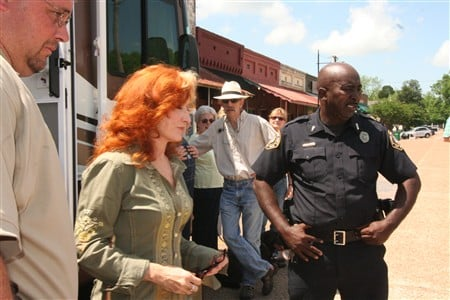 Mike Davis (left) and Earl Burdette (right) provided security for singer Bonnie Raitt who was not threatened by anything in Como except maybe adulation. Both men are deputies and both serve part-time on the Como Police Department where Davis is interim chief.
