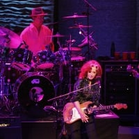 """Bonnie Raitt (center) is accompanied on tour by Ricky Fataar (left) on drums and James """"Hutch"""" Hutchinson on the electric bass guitar as she performs at the Verizon Theater in Grand Prairie on Saturday night, September 29, 2012.  © Stewart F. House /Special Contributor"""