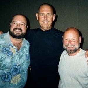 Louis Sall and Scott Curtis flank Steve Raitt. The duo shaved their heads to match Steve's chrome dome