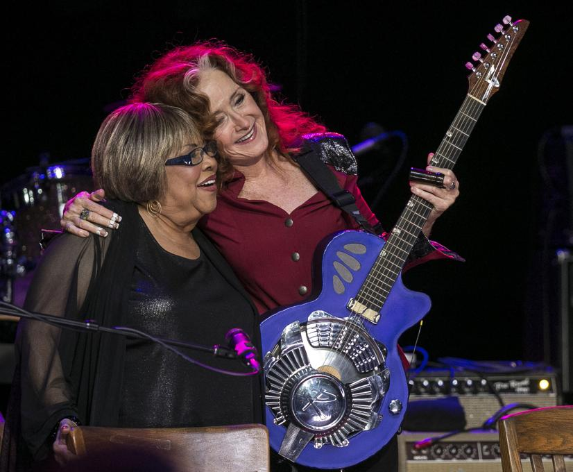 Bonnie Raitt and Mavis Staples, hug after a song during the Austin City Limits Hall of Fame Induction and Celebration held at ACL Live at the Moody Theatre, in Austin, Tx., on Wednesday, Oct. 12, 2016. Performers B.B. King, Bonnie Raitt and Kris Kristofferson, were inducted. (AUSTIN AMERICAN-STATESMAN / RODOLFO GONZALEZ)