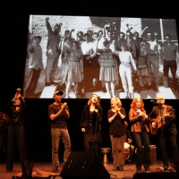 """The memorial ended with a rendition of """"Ain't Gonna Let Nobody Turn Me Around"""" led by Bonnie Raitt, together with the members of the First AME Choir. Left to right: Me, Tom Morello, Barbara Williams, Holly Near, Bonnie Raitt & James McVay with the guitar."""