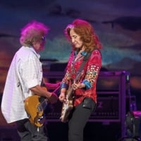 Band member George Marinelli plays alongside Bonnie Raitt as she performes before James Taylor - Saturday, July 15, 2017 at PPG Paints Arena in Uptown.  © Rebecca Droke /Post-Gazette