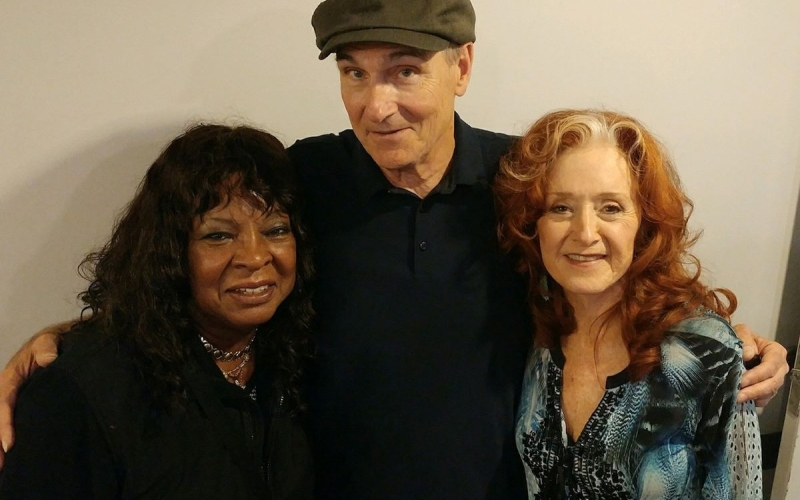 """James Taylor with Bonnie Raitt and Martha Reeves, known for leading """"Martha Reeves & The Vandellas."""" So much talent in one photo!"""
